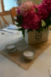 Tea lights, linen and peonies | http://juliesaffrin.com