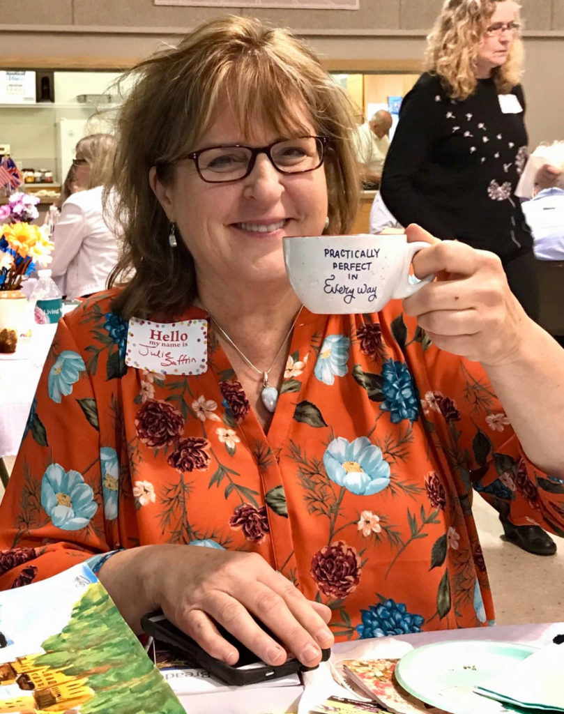 Julie with teacup at women's retreat | Photo Credit Amy Boucher Pye